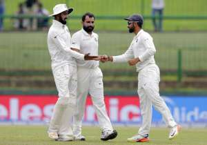 Mohammed Shami celebrates with teammates the dismissal of
