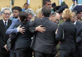 Foreign diplomats embrace each other as they attend a ceremony to offer tribute to the victims of the attack on Holey Artisan Bakery, at a stadium in Dhaka, Bangladesh.