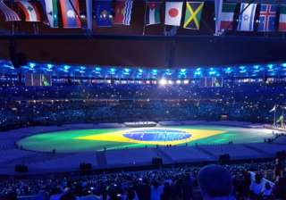 Time for the national anthem of Brazil and the country's flag to enter the arena.