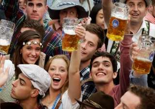 Young people celebrate the opening of the 183rd Oktoberfest beer festival.