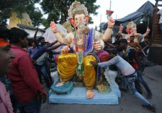Indians prepare to load an idol of elephant headed Hindu god Ganesha on to a vehicle on the eve of Ganesh Chaturthi festival in Ahmadabad.