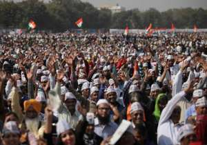 Supporters of Aam Aadmi Party cheer during the swearing in- India Tv