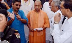 Adityanath being briefed about the bridge made on the- India Tv