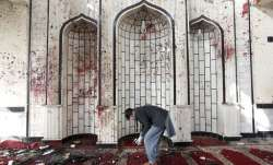 An Afghan man inspects inside a damaged mosque in Kabul, Afghanistan.