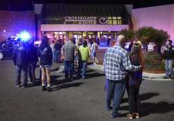 People stand near the entrance of Crossroads Center mall in