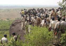 File pic - Police at encounter site of SIMI operatives near