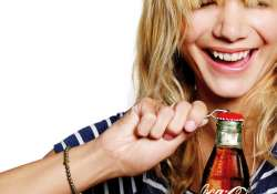 A Coca-Cola bottle that clicks a selfie in a jiffy