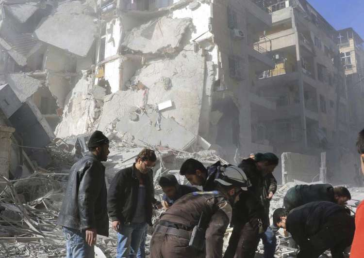 Damaged building after airstrikes in Aleppo, Nov 19- India Tv