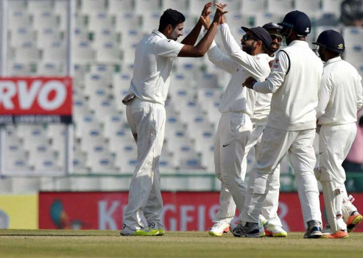 R Ashwin celebrates with team mates dismissal of England's- India Tv
