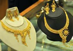 dhanteras pushes up gold by rs 100 silver by rs 300