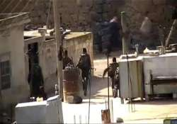 syrian troops shell central city say activists