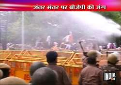 delhi police use teargas water cannons on bjp activists