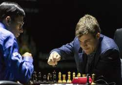 anand loses sixth game to carlsen trails by one point now