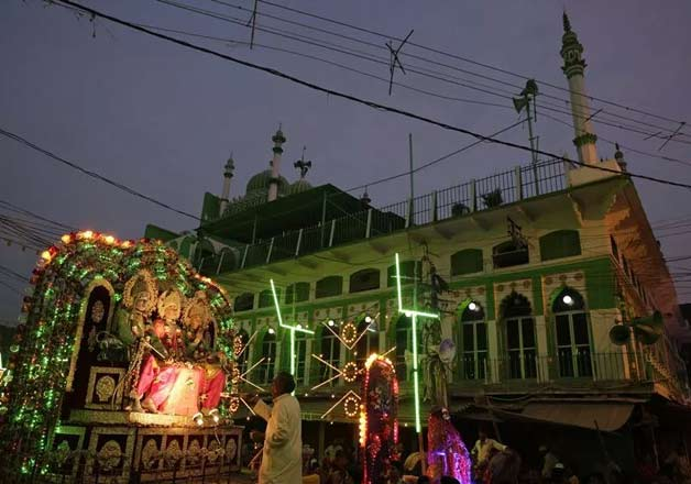 Revellers gather during a religious procession ahead of Dussehra festival in Allahabad. The Hindu festival celebrates the victory of good over evil.