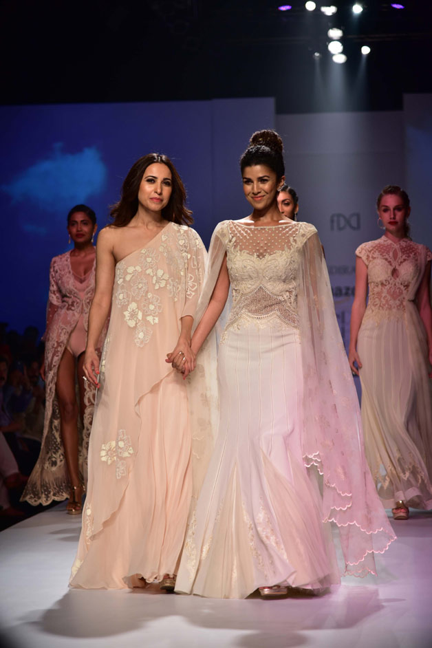 Nimrat Kaur looked every inch of royalty in a beautiful white gown by designer Mandira Wirk's latest collection titled New Royals.