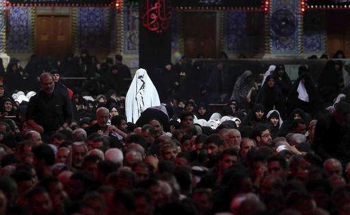 Shiite worshippers pray inside the shrine of Imam Hussein during the Muslim month of Muharram, in Karbala, 50 miles (80 kilometers) south of Baghdad, Iraq.