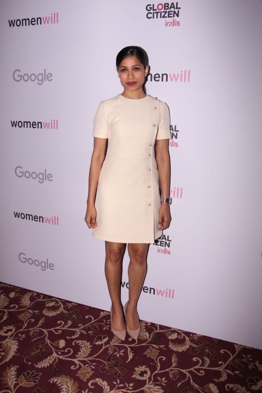 Frieda Pinto gave a chic look with her cream faux pearl wool dress by Gucci. She finished her look with a pair of nude pumps, a berry lip and a sleek ponytail.