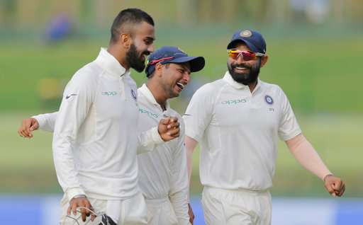 Kuldeep Yadav shares a laugh with teammates Mohammed Shami and Lokesh Rahul as they leave the ground at the end of second day's play in Pallekele against Sri Lanka