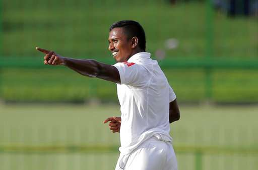 Pacer Vishwa Fernando celebrates the dismissal of India's Ravichandran Ashwin on the first day of the third Test in Pallekele