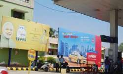 Remove hoardings with PM's photo from petrol pumps: Congress