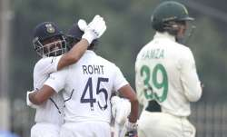 India's Ajinkya Rahane, left, hugs teammate Rohit Sharma to