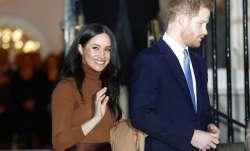 Prince Harry with wife Meghan Markle