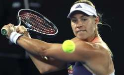 Germany's Angelique Kerber makes a backhand return to
