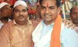 A photo showing BJP leader Kapil Mishra and former AAP