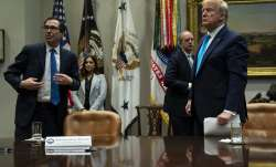 Treasury Secretary Steven Mnuchin and President Donald Trump listen to a question during a conferenc