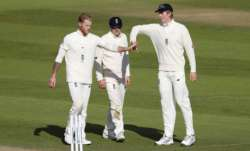 Ben Stokes of England celebrates with Dom Bess and Zak