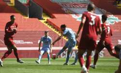 Burnley's Jay Rodriguez, center, shoots and scores his