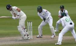 England's captain Joe Root, left, plays a shot during the