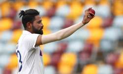 India's Mohammed Siraj gestures with the ball as he leaves