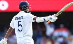 Washington Sundar of India celebrates his half century