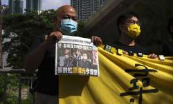 Pro-democracy activists holding a copy of Apple Daily