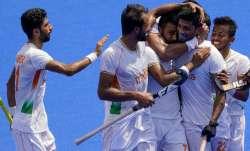 India's Varun Kumar (22) celebrates with his teammates after scoring