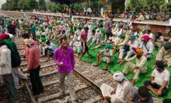 Farmers block the train tracks at a railway station during