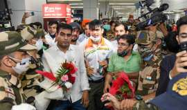 Frenzy, chaos as history-making Indian Olympic contingent returns from Tokyo - In Photos