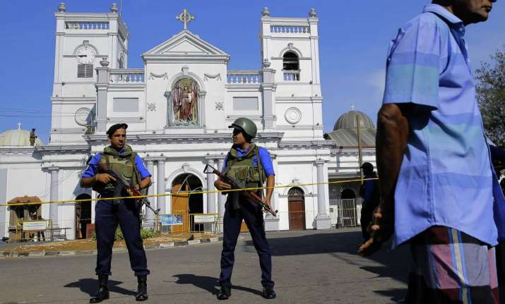 Soldiers stand guard in front of the St. Anthony's Shrine a