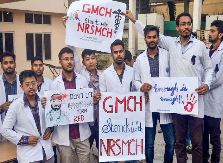 Medical student hold placards showing solidarity with the